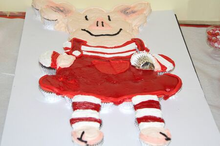 Cupcakes made into a red piglet cake form Stock Photo