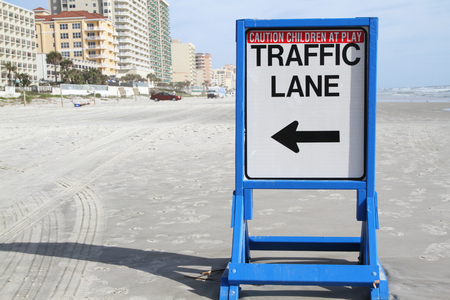 Traffic lane sign for cars on a beach in Daytona, Florida