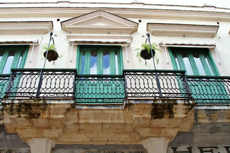 Old architectural building with wrought iron railing in Havana, Cuba