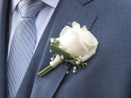 Closeup of  white rose on the lapel of a bridegroom Stock Photo