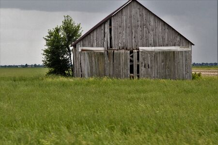 Old grey barn in rural countryside Stock Photo