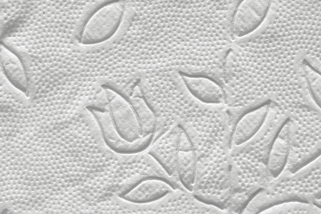 Napkin white paper. Texture of paper with perforation with a pattern of flowers.