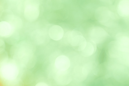 Blurred shiny green background for New Year greeting card.