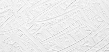 White background. Texture of paint and plaster on the wall with patterns and stripes.