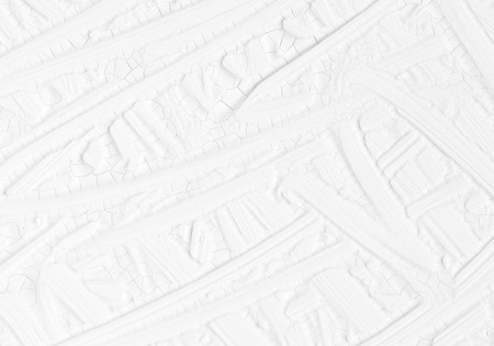 Texture of a paint of white color with patterns. Background with divorces for various purposes. Stock Photo