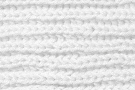 The background is white. The texture of the knitted fabric is made of woolen threads handmade. Stock Photo