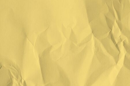 Paper beige color is crumpled and aged. Wrinkled in vintage retro style.