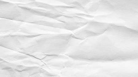 White crumpled paper background, texture old for web design screensavers. Template for various purposes or creating packaging.