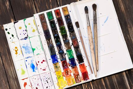 aquarel: Watercolor palette with old brushes Stock Photo