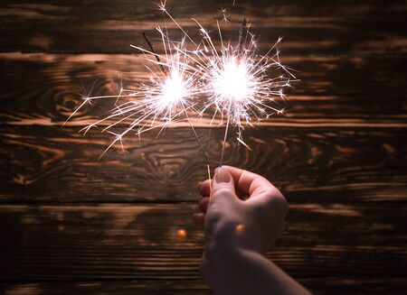 Sparklers in woman hands 写真素材