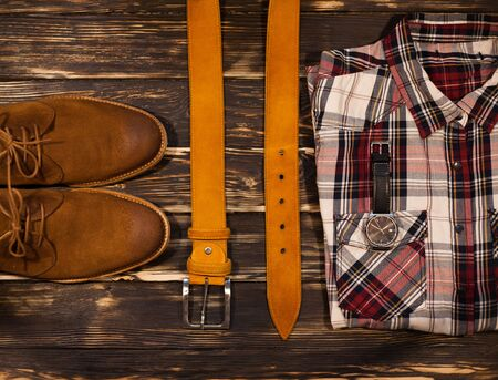 clasp feet: Mens brown clothing and accessories set: boots, leather belt