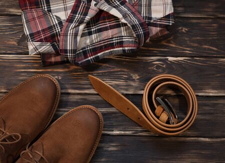 Mens brown clothing and accessories set: boots, leather belt
