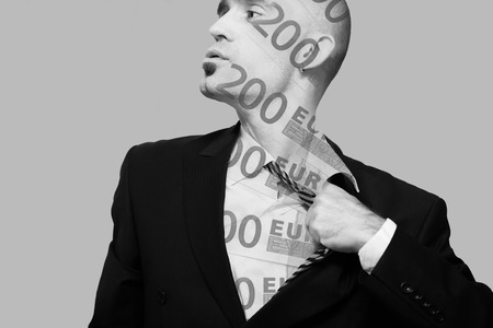 Tired man in business suit taking off his tie, double exposure, money.