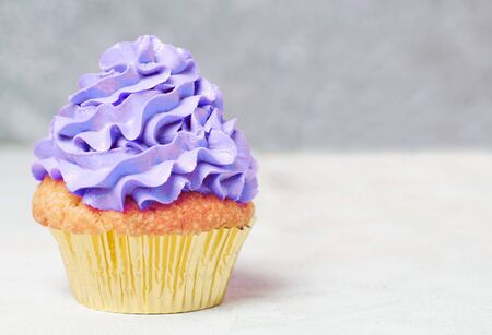 Ultra violet cupcakes with copyspace. Festive and bright. Holiday Celebration concept.