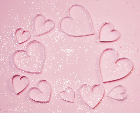 Pink hearts and sparkles on pink background. St. Valentines greeting concept, romantic style. Top view, flat lay, place for text Stock Photo