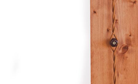 Retro style electrician on wooden house, close up, isolated on white.