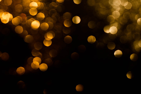 Magic lights christmas bokeh on black background. Can be used for your photos. Stock Photo