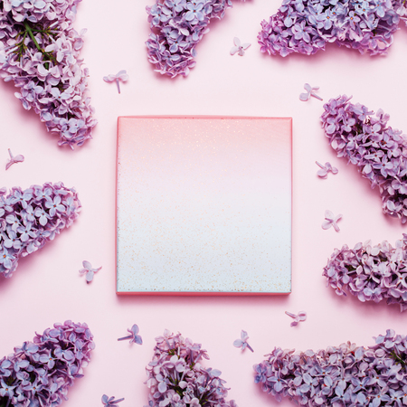 Lilac holiday background with place for text. Top view, flat lay of beautiful spring flower background.