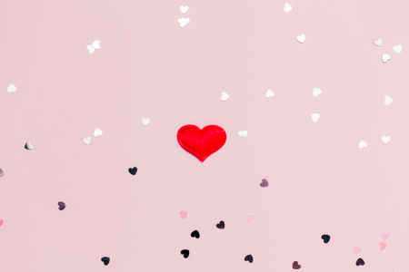 Pink confetti and stars and sparkles on pink background. Top view, flat lay. Copyspace for text. Bright and festive holiday background. For Valentines day. 스톡 콘텐츠
