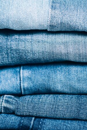 Stack of jeans on table. Zero vaste concept. Ecology and recycling. Stock Photo