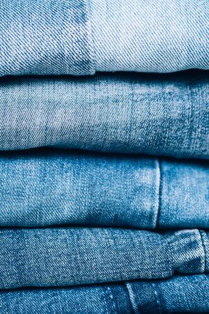 Stack of jeans on table. Zero vaste concept. Ecology and recycling. Banque d'images - 127148227