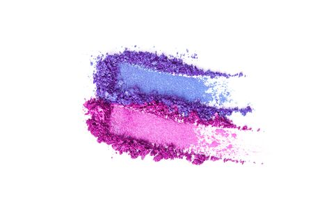 A broken pink and blue eye shadow smear make up palette isolated on a white background. Top view, flat lay. Copy space for your text Banque d'images - 127167330