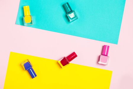 Colorful Nail polish bottles pattern background. Close up. Stock Photo
