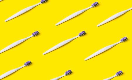 Toothbrush minimal pattern on yellow background.