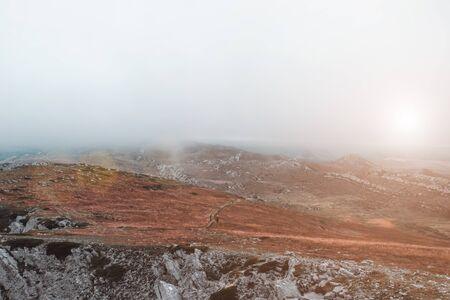 Foggy mountain landscape. Autumn weather.