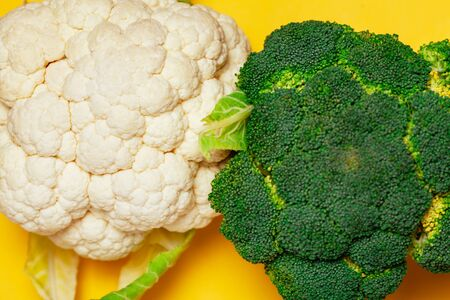 Broccoli and cauliflower macro on yellow background. minimal vegetarian concept. Top view, flat lay. Vegan day. 写真素材 - 133276398