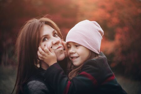 Beautiful mother and daughter hugging in autumn forest. 写真素材 - 134737904