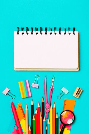 Colorful pink background with various School accessories and stationery are laid out in the form of a rainbow. Empty notebook, mock up. Flat lay top view. 写真素材 - 134737907