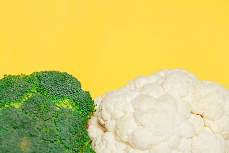 Broccoli and cauliflower macro on yellow background. minimal vegetarian concept. Top view, flat lay. Vegan day.