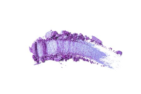 A broken violet eye shadow texture isolated on a white background. Top view, flat lay. Copy space for your text
