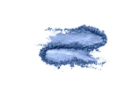 A broken colored in color of year 2020 classic blue eye shadow make up palette. flat lay. Copy space for your text. Creative fashion and beauty living coral concept. 写真素材