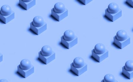 Top view of plastic blocks background colored in Classic Blue color of 2020. Flat lay image of toy background. 写真素材