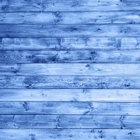 wooden pannels texture colored in color of year 2020 classic blue background. 写真素材