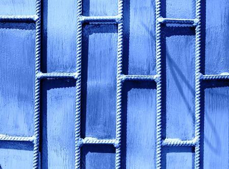 Metal bar background in color of 2020 Classic Blue.