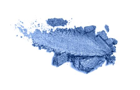 A broken colored in color of year 2020 classic blue eye shadow make up palette. flat lay. Copy space for your text.