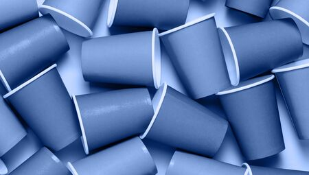 Plastic cups background. Classic blue concept of environment pollution. Top view, flat lay.