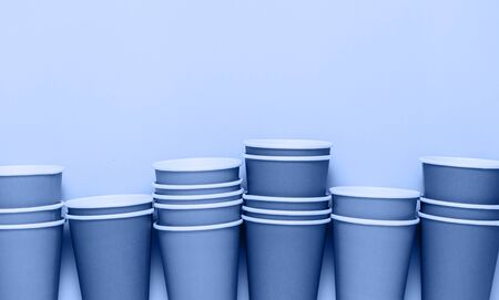 Plastic cups background. Classic blue concept of environment pollution. 写真素材