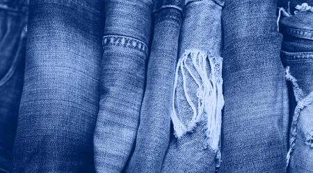 Stack of jeans on table. classic blue color. 写真素材
