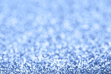 confetti and stars and sparkles on Classic Blue Christmas background. Top view, flat lay.
