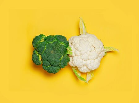 Broccoli and cauliflower macro on yellow background. minimal vegetarian concept. Top view, flat lay. Vegan day.