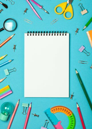 Colorful pink background with various School accessories and stationery are laid out in the form of a rainbow. Empty notebook, mock up. Flat lay top view. 写真素材