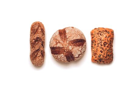 Different kinds of bread on white backdround. Top view, flat lay.