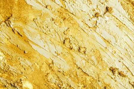 Golden paint texture. Macro view.