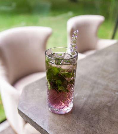 Lavender ice tea on summer veranda. Stock fotó