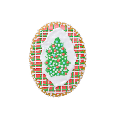 cookie christmas tree gingerbread with snow isolated on white