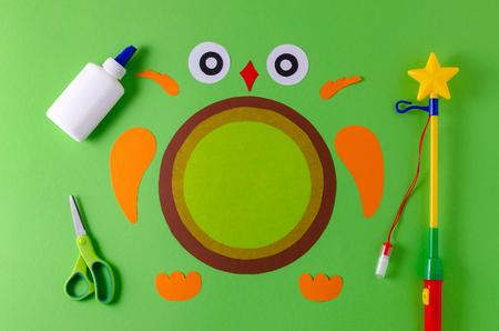 details of diy owl lantern for sankt martin, traditional german feast, color paper, glue, scissors, lanterns wand
